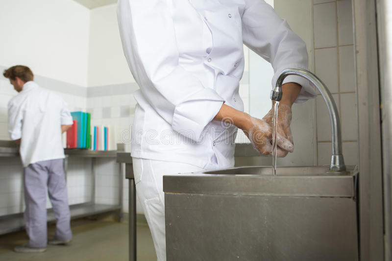 Chef washing hands prior to cook stock images