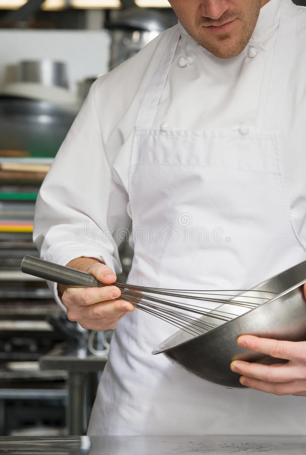 Chef whisking royalty free stock image