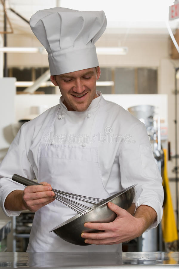 Chef whisking stock image