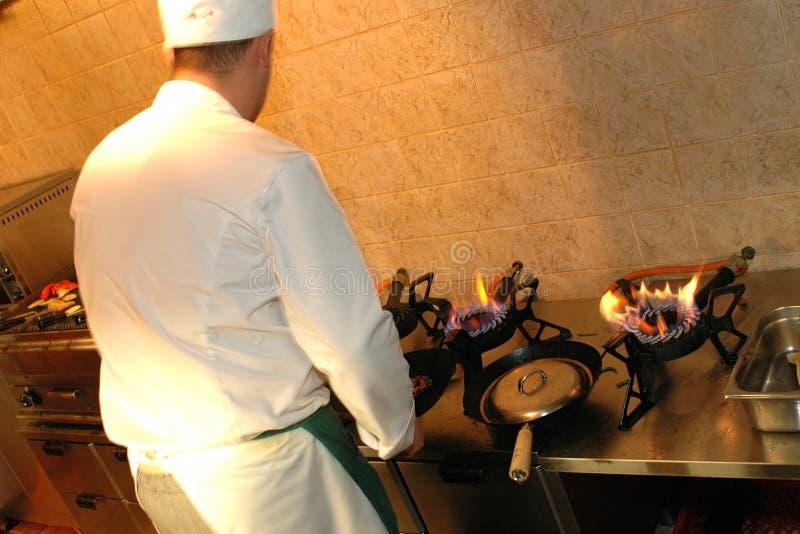 Chef at work. Busy kitchen shot of a restaurant in Tallinn, Estonia