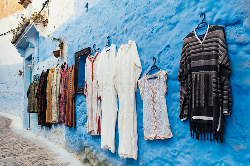 Chefchaouen medina, Morocco, Africa. Traditional garments hanged against bright blue background in Chefchaouen, Morocco, Africa stock photos