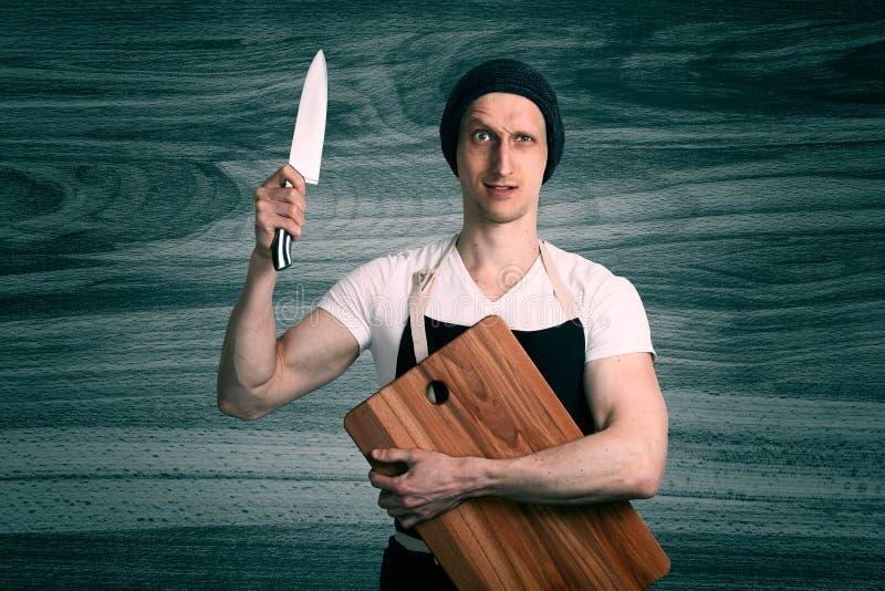 Chefe com uma faca fotografia de stock