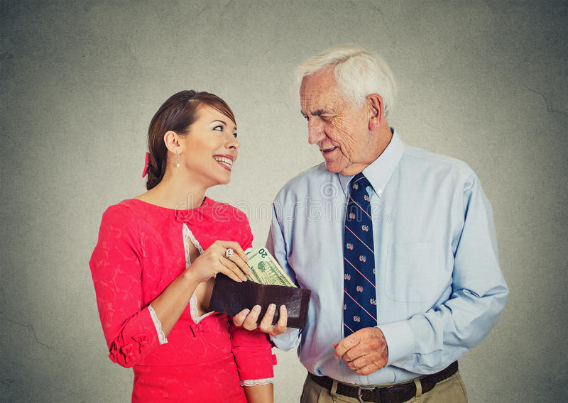 Chefe idoso do homem de negócios e sua senhora nova bonita imagem de stock