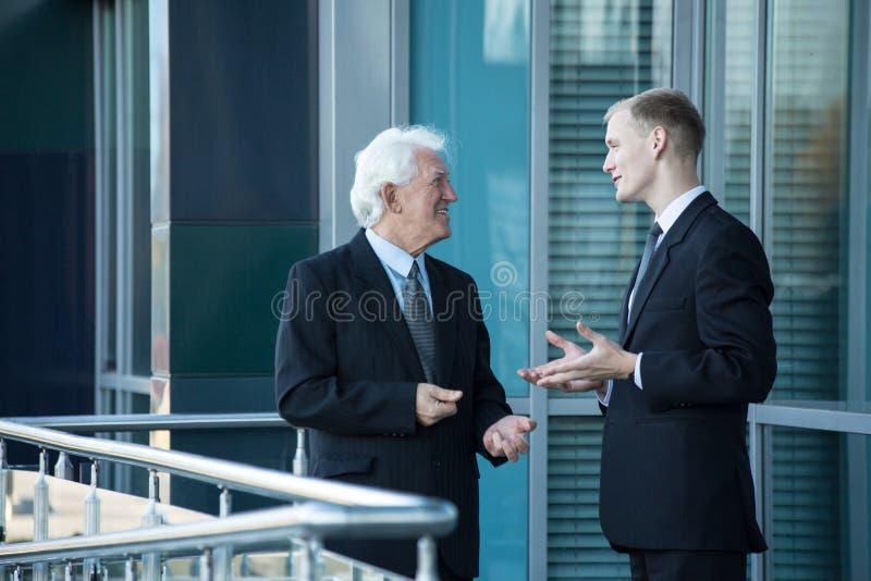Chefe superior e seu empregado imagem de stock