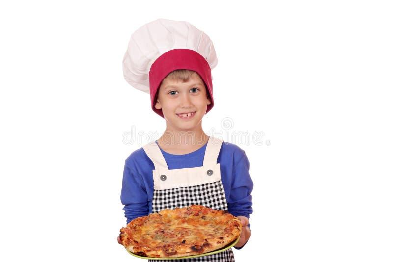 Chefjunge mit Pizza stockbilder