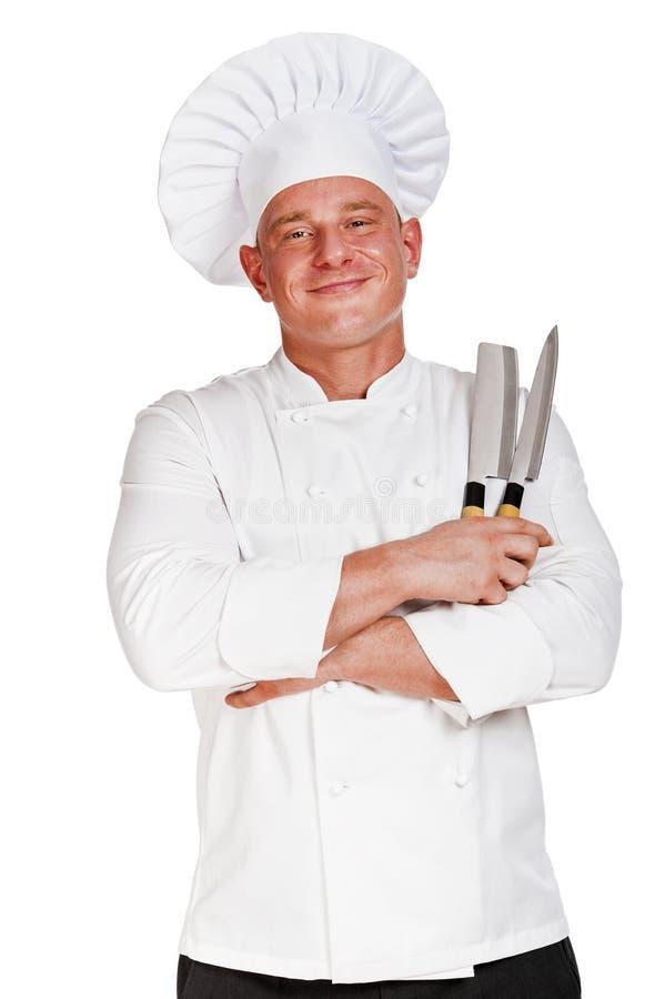 Chefmann, der zwei Messer hält stockbild