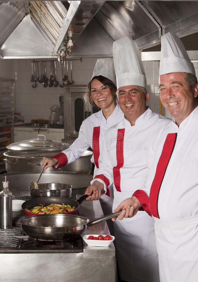 Chefs. Group of young beautiful professional chefs portrait royalty free stock photos