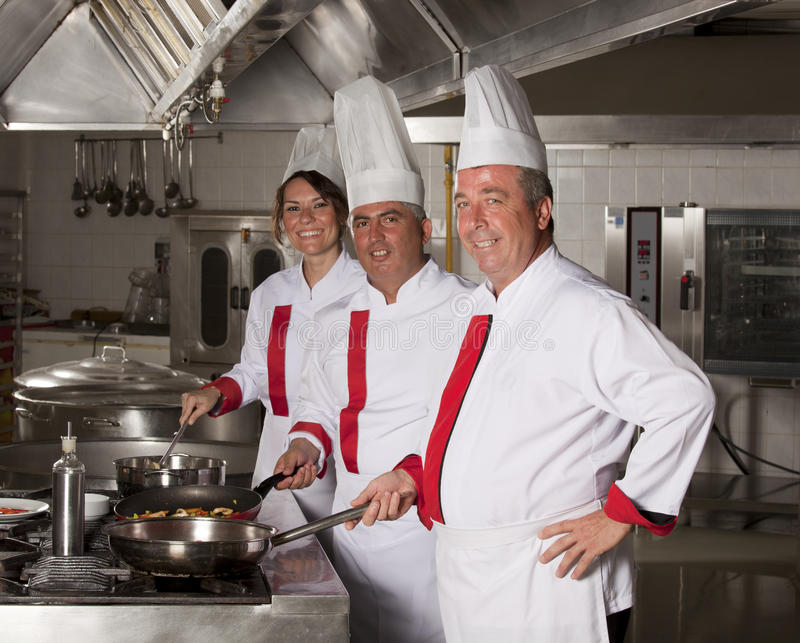 Chefs. At work in a kitchen stock image