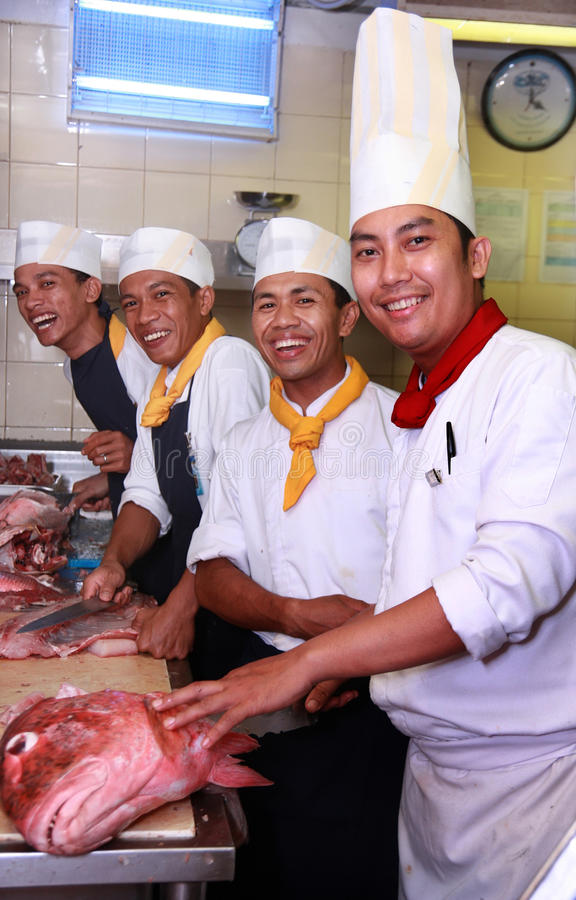 Chefs. In the kitchen butcher stock photography