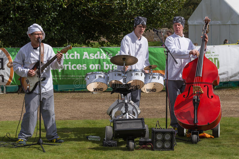 Chefs Band. BISHOP AUCKLAND, ENGLAND - April 19, 2015: Musician Chefs Band in Bishop Auckland Food Festival. Bishop Auckland Food Festival is organised by Durham stock photography