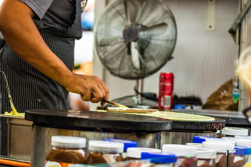 Chefs making and selling crepes, pancakes at a food festival in Bucharest, Romania – 2019.  royalty free stock photography