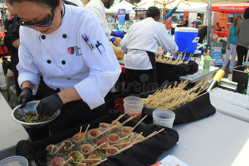 Chefs from many restaurants getting ready for Encinitas Foodie Fest, Lumberyard, California, 2016. View of several chefs busy preparing their entry to The royalty free stock images