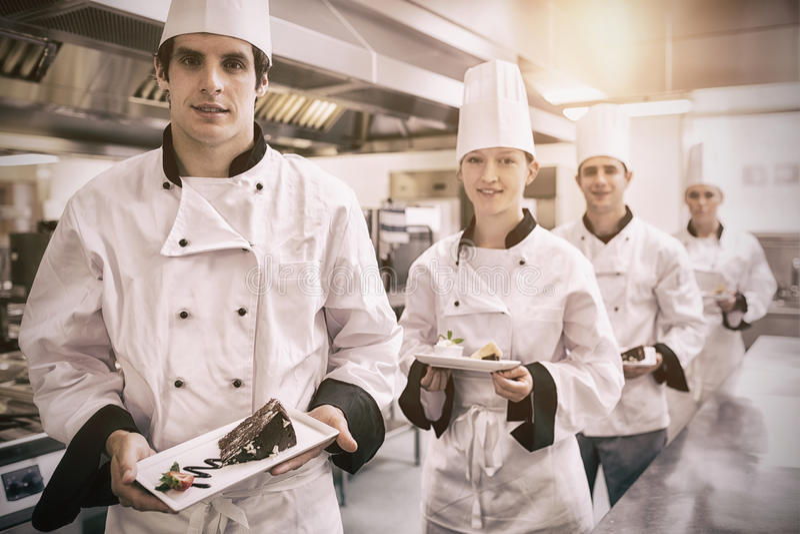 Chefs presenting deserts stock photos