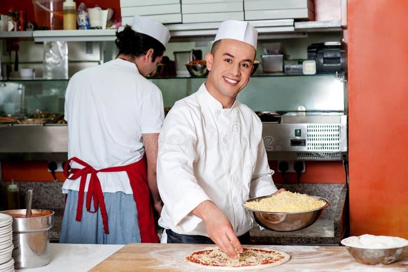 Chefs at work inside restaurant kitchen. Male chefs working in kitchen, back-office shot stock photos