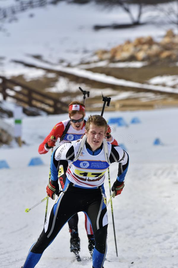 Cheile Gradistei Roamania - Januari 30: Okänd konkurrent i IBU Youth& Junior World Championships Biathlon 24th Januari 2016 t arkivfoto