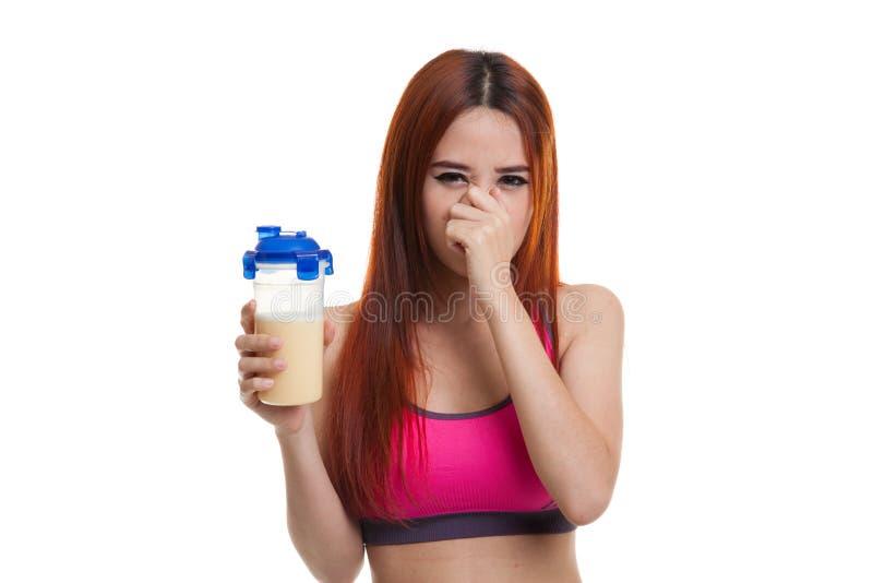 Cheiro saudável asiático bonito da proteína do soro do ódio da menina fotografia de stock