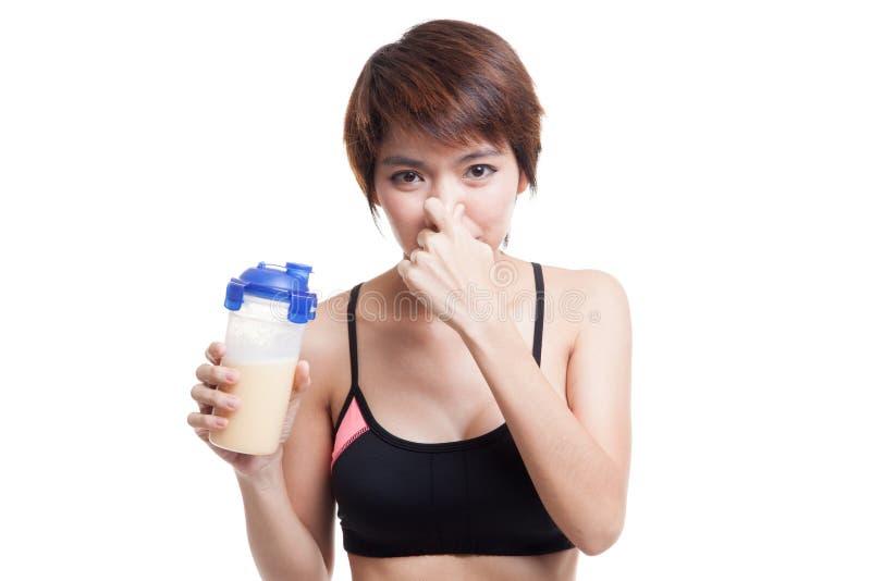 Cheiro saudável asiático bonito da proteína do soro do ódio da menina imagem de stock
