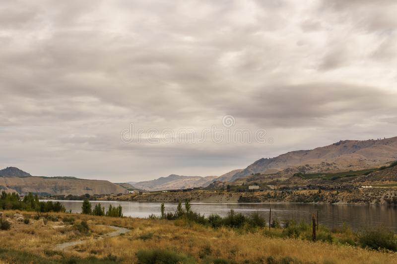 Chelan, , USA - September 16, 2018: Beautiful Autumn Scenery landscape with Columbia river and prairie . stock photo