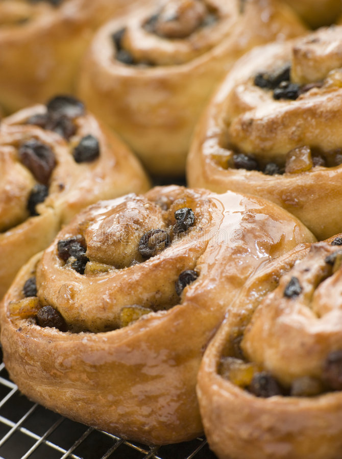 Chelsea Buns on a cooling rack stock photography