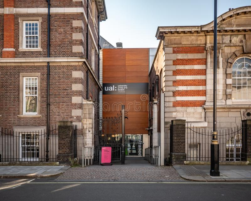 Chelsea College of Arts, London. LONDON, UK - 27 FEBRUARY 2019: A secluded side entrance into the Chelsea College of Arts building. The college is part of the royalty free stock images