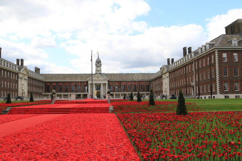 Chelsea Hospital for Pensioners. The grand poppy display at the Chelsea Show in 2016. Knitted poppies adorn the grass, as a remembrance to those soldiers who stock photos