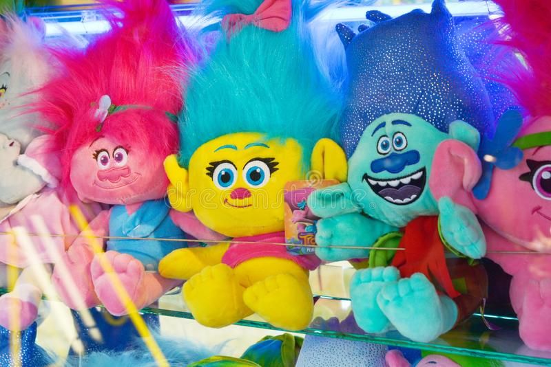 Cheltenham, United Kingdom. June 22, 2019 - stuffed animal toys from Trolls movie, amusement park. Stuffed animal toys on the wooden floor isolated on white royalty free stock image