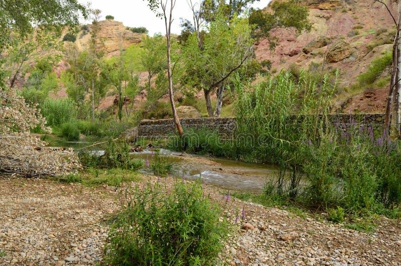 Chelva van de watersleep rivier stock foto's