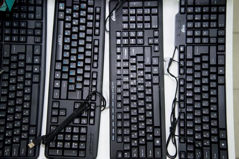 Chelyabinsk Region, Russia - February 2019. Black keyboard for a computer with a Russian font on the storefront royalty free stock images