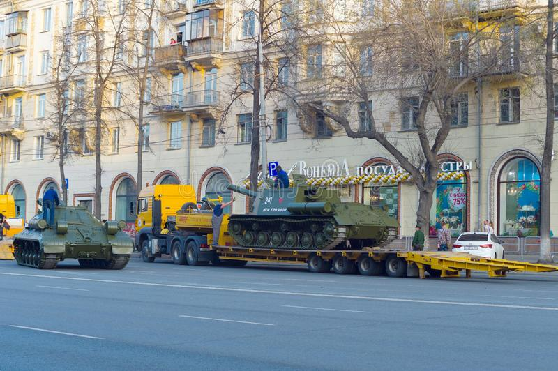 The loading supervisor gives a stop signal for ISU-152. Chelyabinsk, Russia - May 2019: Transportation of heavy armored vehicles along Lenin Avenue. The loading stock photo