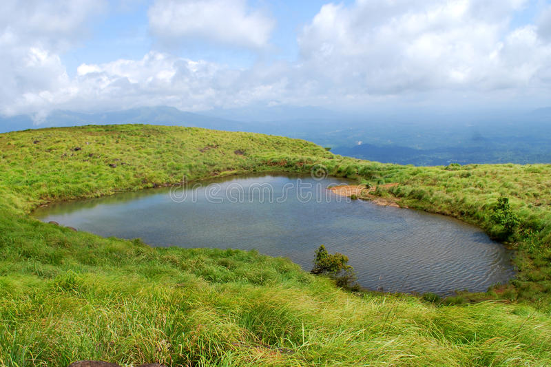 Chembra peak lake. Chembra Peak is the highest peak in Wayanad, at 2, 050 m above sea level. Chembra is located near the town of Meppady and is 8 km south of stock photography
