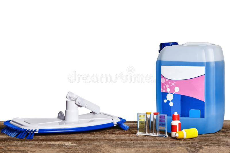 Equipment with chemical cleaning products and tools for the maintenance of the swimming pool on a wooden surface against. Chemical cleaning product, test tubes royalty free stock photo