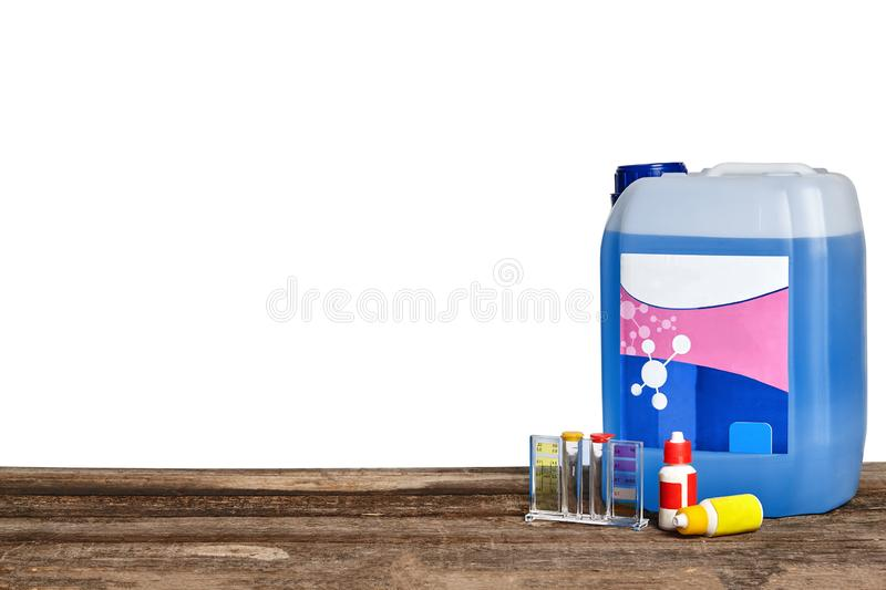 Equipment with chemical cleaning products and tools for the maintenance of the swimming pool on a wooden surface against. Chemical cleaning product, test tubes royalty free stock photography