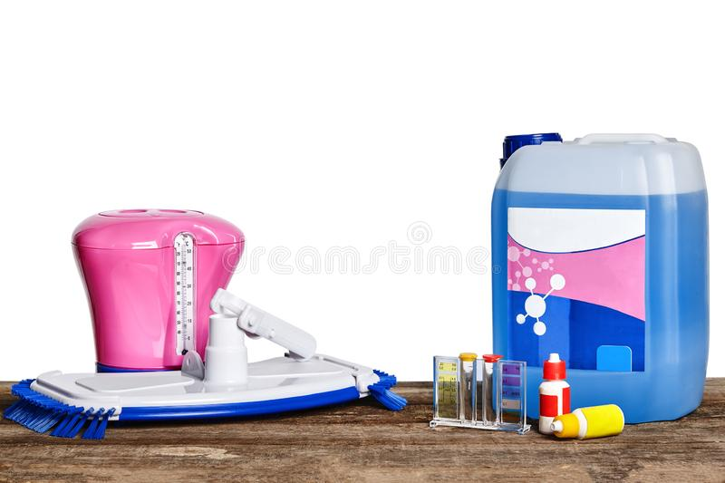 Equipment with chemical cleaning products and tools for the maintenance of the swimming pool on a wooden surface against. Chemical cleaning product, test tubes stock images