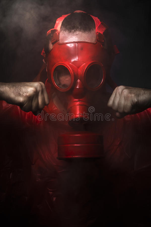 Chemical concept, man with red gas mask.