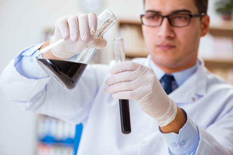 The chemical engineer working on oil samples in lab. Chemical engineer working on oil samples in lab royalty free stock photo