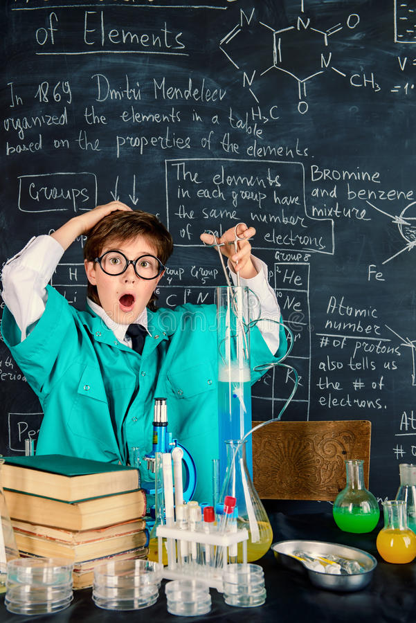 Chemical experiments in the lab. Smart boy scientist making chemical experiments in the laboratory. Educational concept. Discovery royalty free stock photos