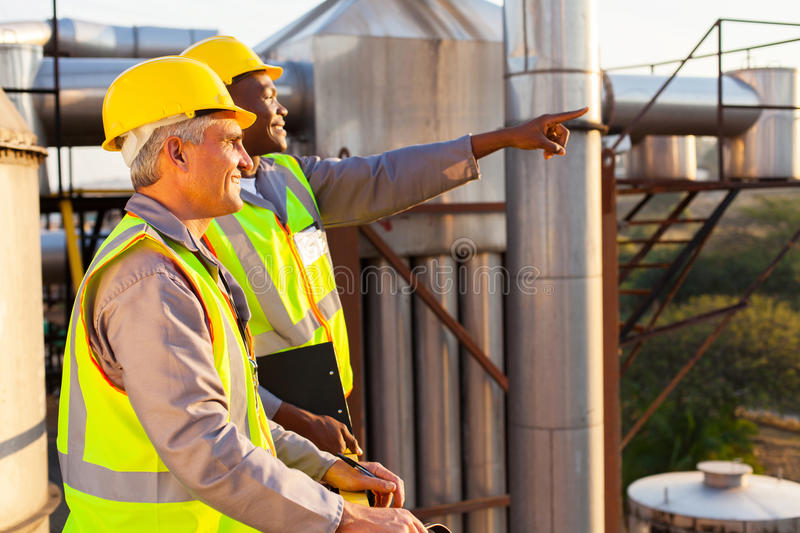 Chemical factory workers. Two chemical factory workers working in plant stock images