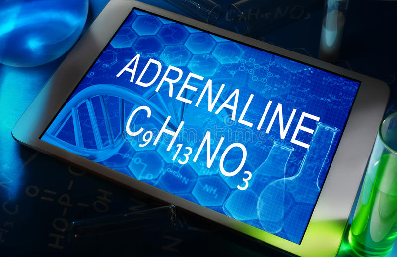 The chemical formula of adrenaline. On a tablet with test tubes stock images