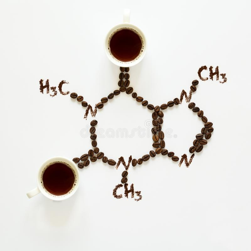 Chemical formula of Caffeine. Cups of espresso, beans and coffee powder. Art food. Top view stock photography