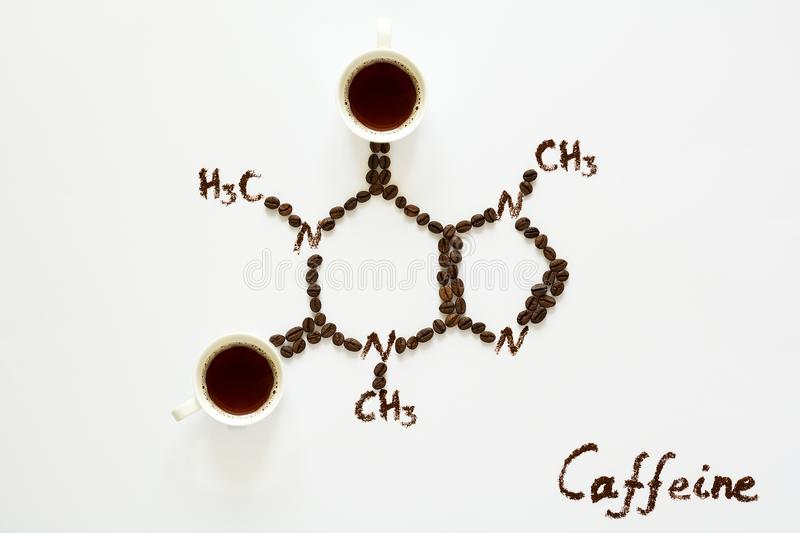 Chemical formula of Caffeine. Cups of espresso, beans and coffee powder. Art food. Top view royalty free stock images