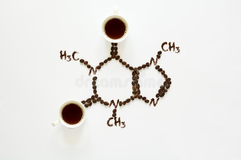 Chemical formula of Caffeine. Cups of espresso, beans and coffee powder. Art food. Top view stock photo