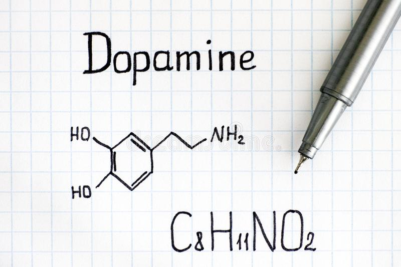 Chemical formula of Dopamine with pen. stock photos