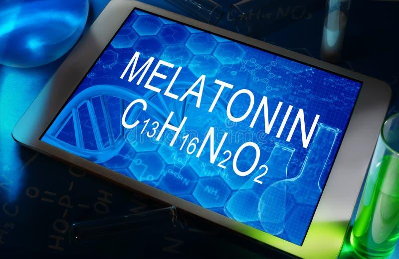 The chemical formula of melatonin royalty free stock photo