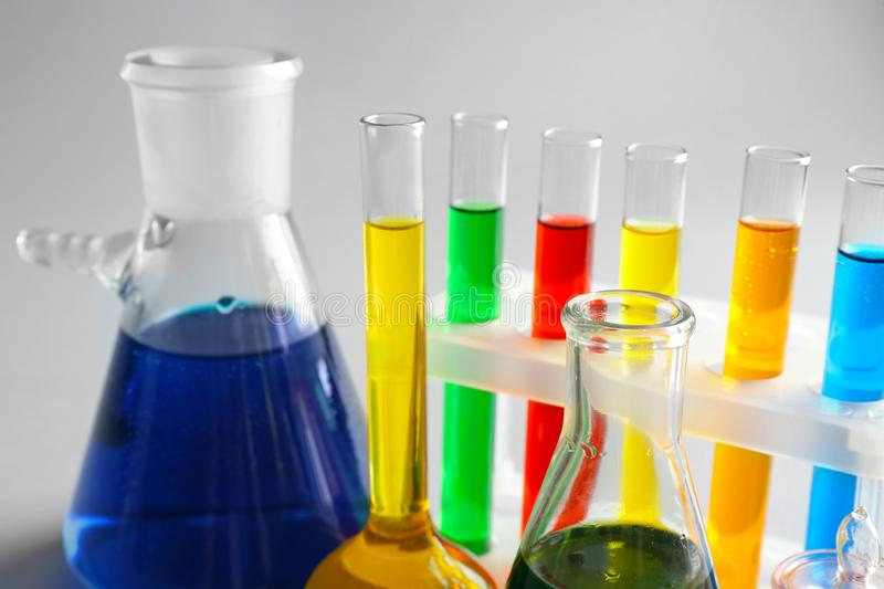 Chemical glassware with colorful samples on light background, closeup royalty free stock photo