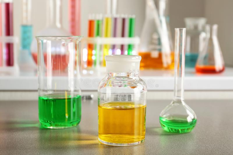 Chemical glassware with colorful samples on table in laboratory stock images