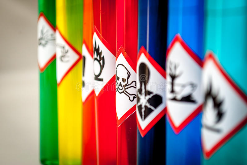 Chemical hazard pictograms Toxic focus. With multiple colored test tubes royalty free stock photo