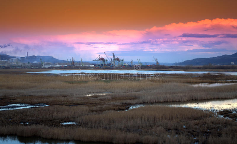 Chemical industrial zone Varna port. Marshland Varna lake port,Varna lake dismal and industrial zone,dramatic sunset skies ,Devnia,Bulgaria stock photography
