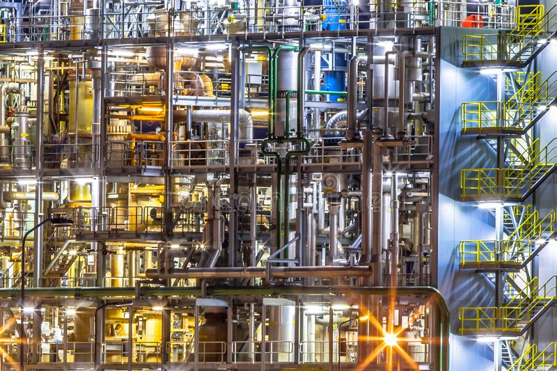 Chemical industry factory details at night royalty free stock image