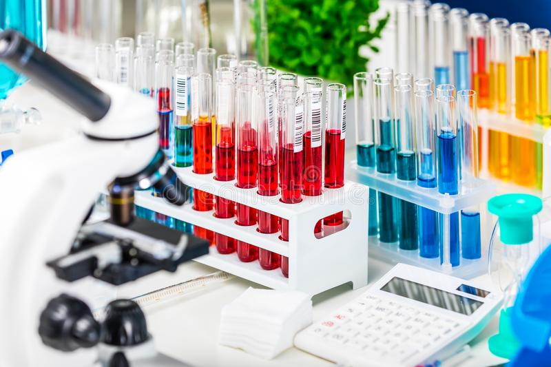 Chemical laboratory equipment. Creative abstract chemistry development, medicine, pharmacy, biology, biochemistry and research technology concept: table with stock photo