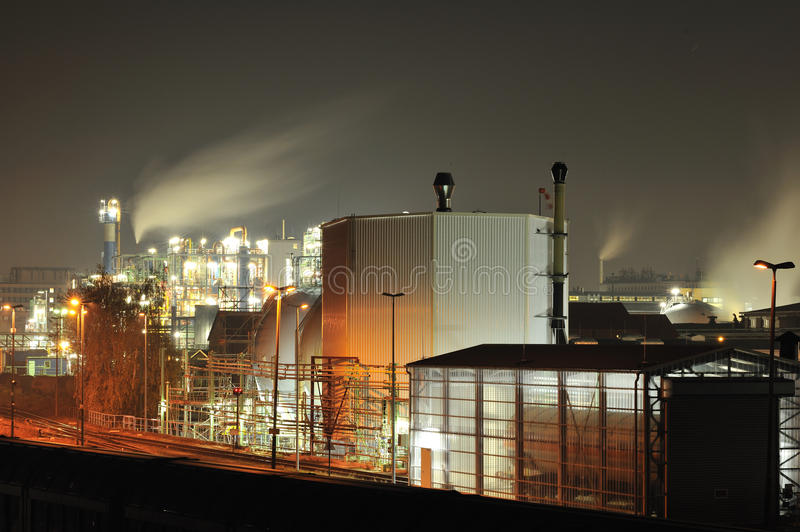 Pharmaceutical and chemical plant by night stock photos